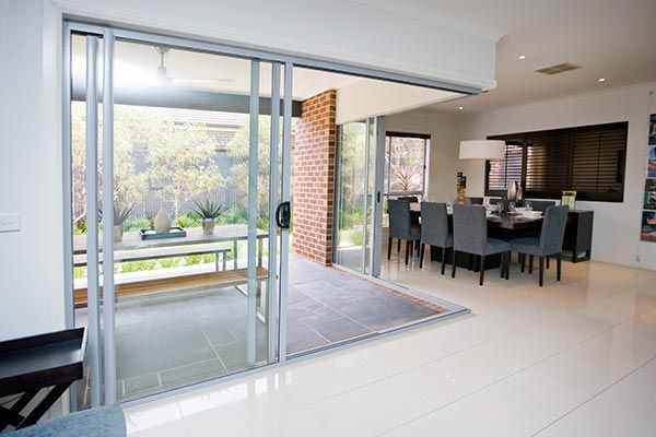 Southern Star Aluminium Stacking Sliding Door opens onto a natural alfresco space. Beautiful and modern!