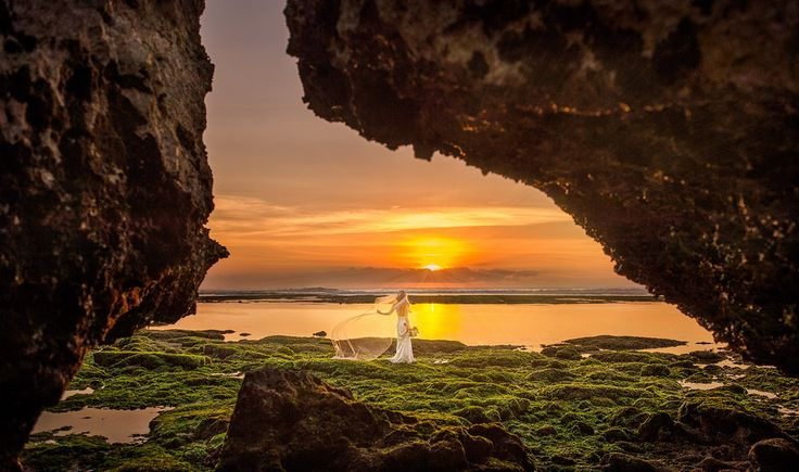 The gorgeous Amanda takes in the last rays of light on her wedding day at Padang Padang on Bali's southern bukit. Image by Marcus Bell