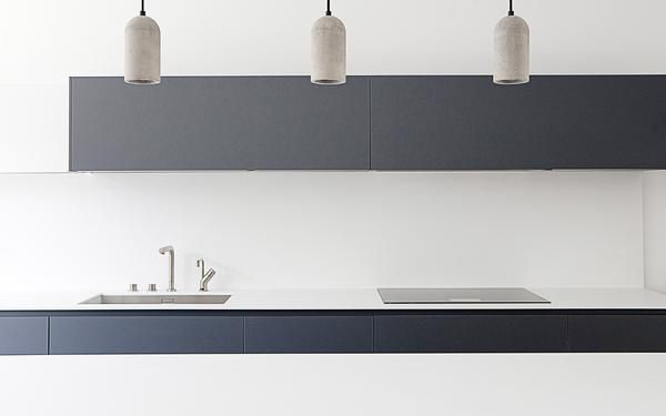 THE MINIMALISTHOUSE House designed and built by Pascal HuserDesign & Build. The kitchen features doors in HPL Fenix-NTM®laminate colour Grigio Bromo and