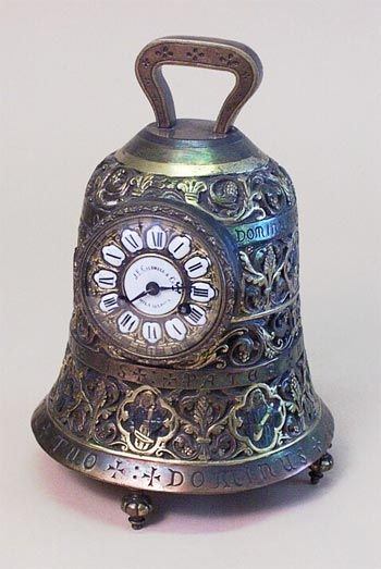 brass bell antique mantel clock-I'd love to get this for my grandmother. She loves bells.