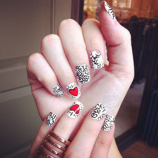 The most amazing Keith Haring #nailart spotted at home office. #urbanoutfitters