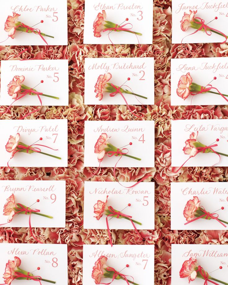Sitting pretty on a bed of coral-and-ivory blossoms, these tags come with a little something extra: a mini-carnation boutonniere. To compose your own display, line a tray with damp floral foam, snip off the flowers' stems, and poke in the buds. Two-tone varieties look especially striking, but a monochromatic scheme (think all pale yellow petals) can be just as fun.  Calligraphy, Jill Velez
