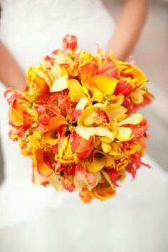 Yellow Craspedia, Yellow Mokara Orchids, Yellow Cymbidium Orchids, Yellow Callas, Flame Orange Callas, Yellow/Red-Orange Gloriosa Lilies Bridal Bouquet