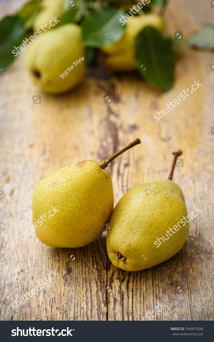 Bio pears on rustic wooden background. Autumn fruits