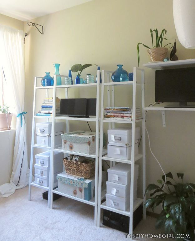 Diary of a Home Office Makeover Part 1 by The DIY Homegirl bedroom closet craft storage workspace white IKEA Lerberg shelves photo storage boxes colored glass peacock bins teal cobalt blue turquoise