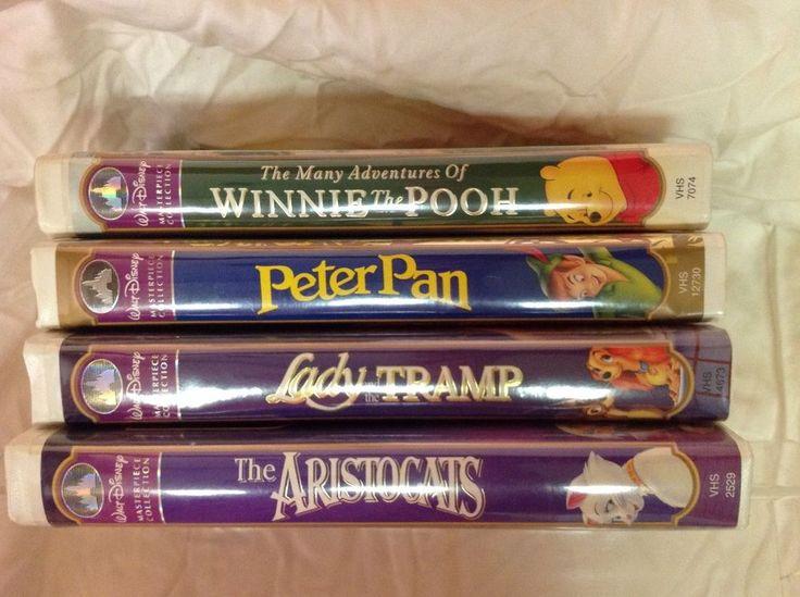 LOT OF 4 WALT DISNEY VHS MASTERPIECE COLLECTION ARISTOCATS PETER PAN TRAMP POOH