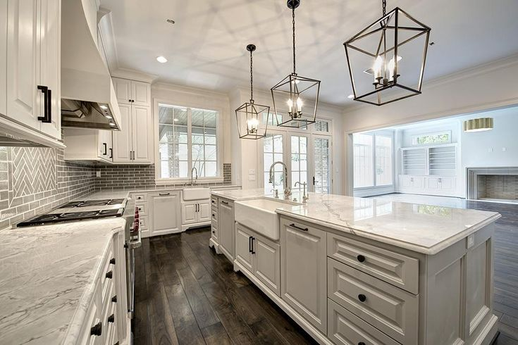 Kitchen with high ceilings, marble countertops, 2 farm sinks, 2 dishwashers with cabinet fronts, walk-in pantry, 3 ovens (1 is steam oven), open to breakfast, wet bar and family room, Wolf gas range