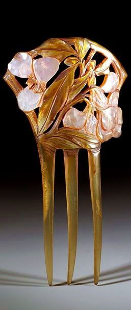 Typical French Art Nouveau comb decorated with pearly pink flowers painted on horn, c. 1900, Creative Museum.