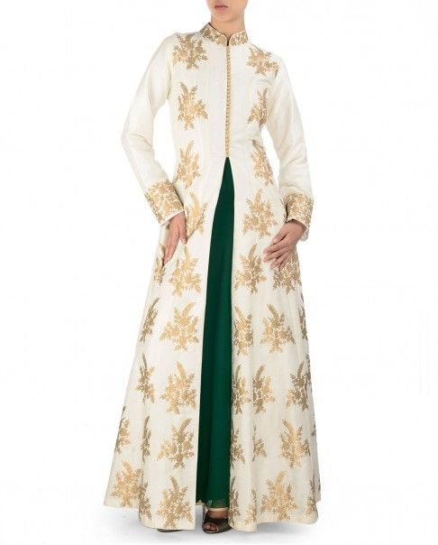 Ivory ankle length front open anarkali jacket. Aari work Mandarin collar with loop buttons on front. Long sleeves with embroidered cuffs. Golden aari work embroidered motifs adorn the anarkali jacket. Forest green sleeveless anarkali kurtaWash care: Dry clean only