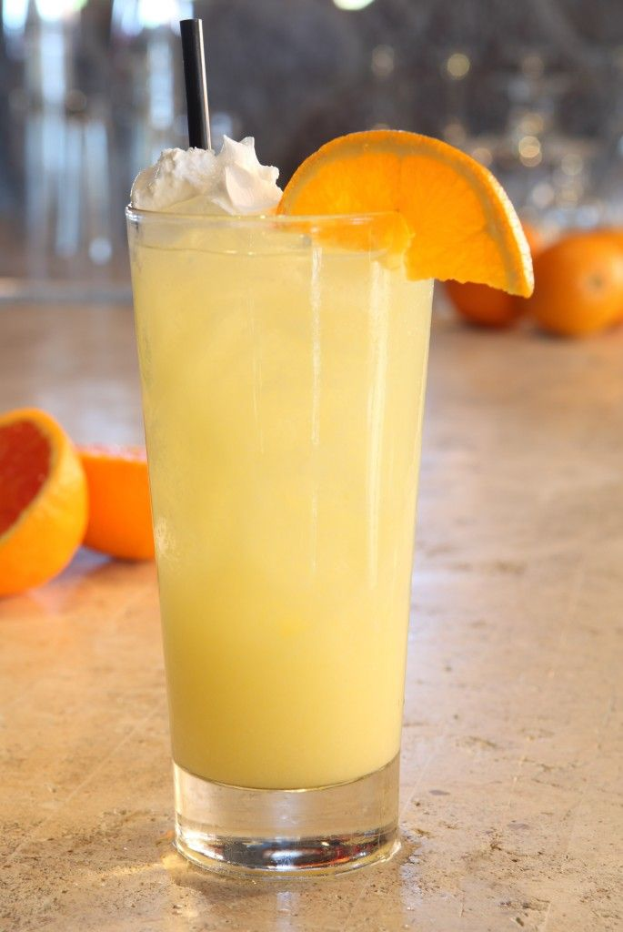 Orange Dreamsicle    1.5 oz. Pinnacle Whipped Vodka    2 oz. orange juice    1 oz. lemon-lime soda    1 oz. soda    .25 oz. cream of coconut    Squeeze 1 lemon slice    Orange slice and whipped cream for garnish    Preparation: Combine with ice and shake all ingredients except for soda. Pour into iced glass and top with soda, garnish with an orange slice and whipped cream.