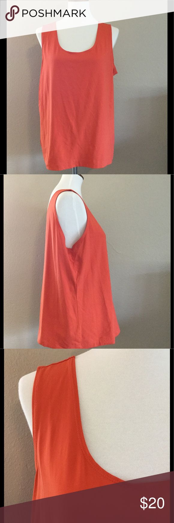 Chico's SZ 3 (XL) Orange Stretchy Cami / Tank Top Women's Chico's orange cami / sleeveless stretchy top size 3. Size 3 is equivalent to size XL top. Top is a great layering piece under cardigans or blazers. In like- new condition.   Fast shipping - same or next business day. Thanks!   Measurements Armpit to armpit: 21 inches  Length: 25 inches Chico's Tops Tank Tops