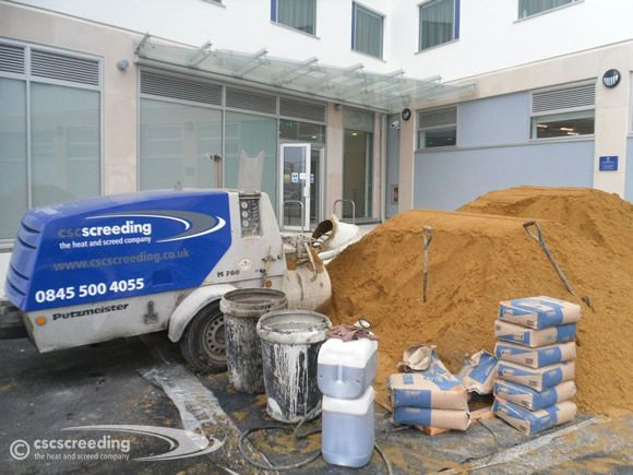 CSC Screeding and pump working on a protected area with screed mix components.