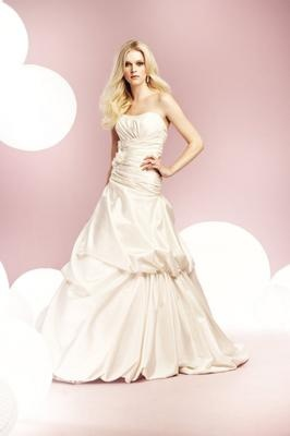 Brand new sample Mikaelle 1554 wedding dress - size 12 - pretty pick ups for a princess look.  $375