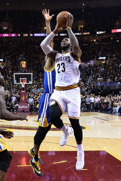 LeBron James Photos - LeBron James #23 of the Cleveland Cavaliers shoots the ball during the first half against the Golden State Warriors in Game 6 of the 2016 NBA Finals at Quicken Loans Arena on June 16, 2016 in Cleveland, Ohio. NOTE TO USER: User expressly acknowledges and agrees that, by downloading and or using this photograph, User is consenting to the terms and conditions of the Getty Images License Agreement. - 2016 NBA Finals - Game Six