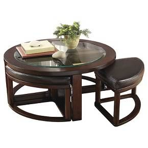 With four wedge-shaped stools seamlessly integrated into its design, this round coffee table might well be your cup of tea. Upholstered in a high-quality faux leather, they're a subtle complement to the burnished wood-color frame. Signature Design by Ashley is a registered trademark of Ashley Furniture Industries, Inc.