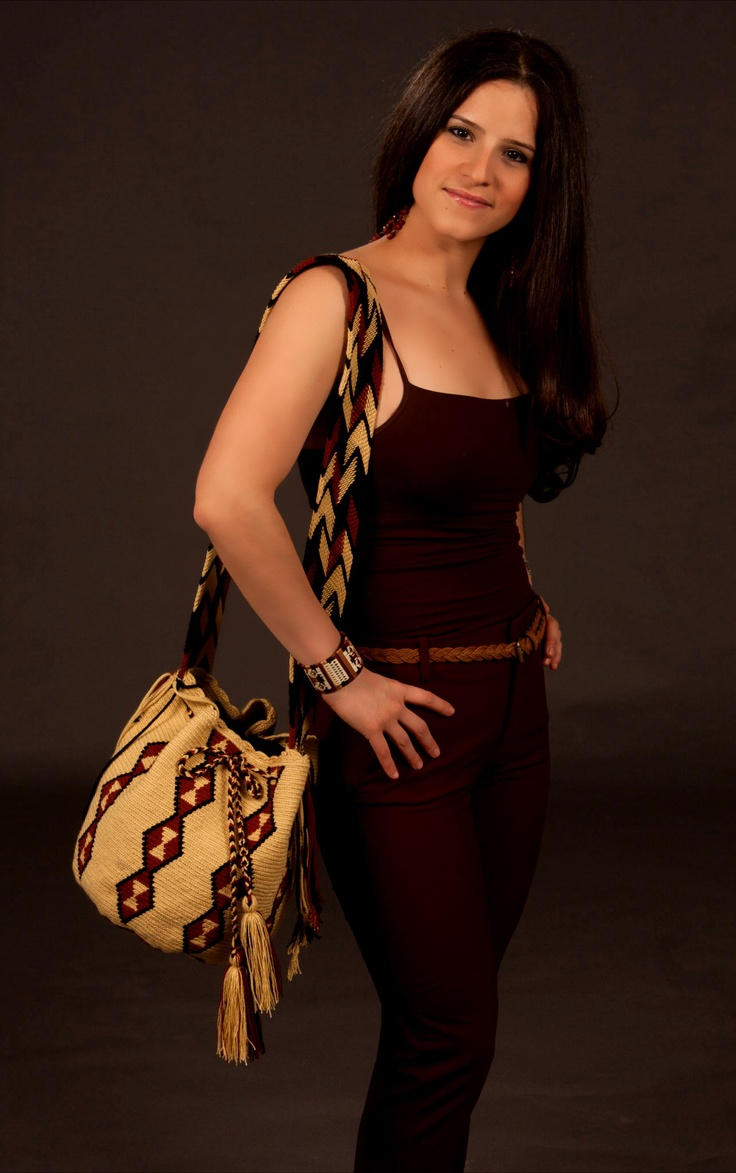 SuSu Doble - the design is on the strap and on the body of the bag.