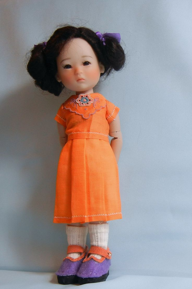 Ten Ping  in a dress made from a vintage linen handkerchief.  Sewn by MarieS
