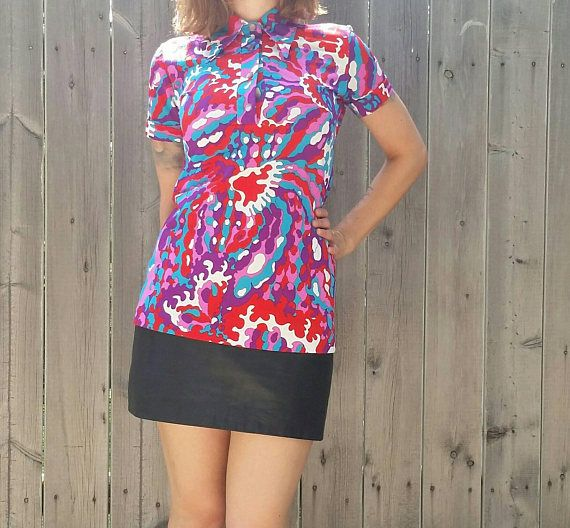 Check out this item in my Etsy shop https://www.etsy.com/listing/546050285/vintage-1960s-psychedelic-polo-wide