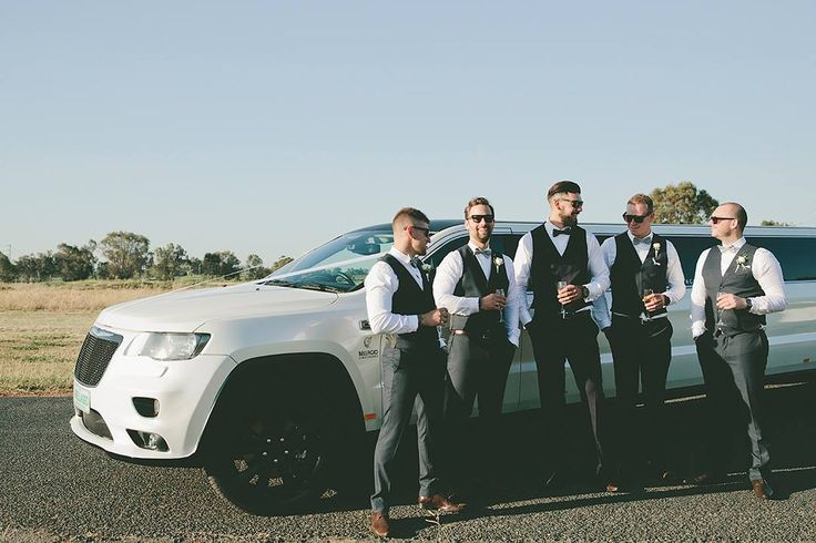 groomsmen in navy suits and tan shoes