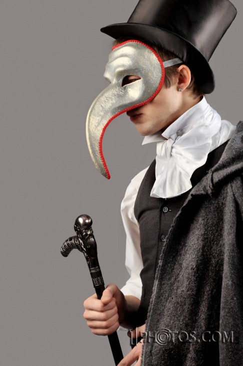 Love this. Not many things are more attractive than a guy in a top hat and waistcoat..give him a mask and it's a winner.