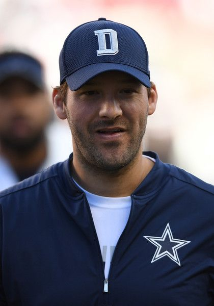 Tony Romo Photos Photos - Injured quarterback Tony Romo #8 of the Dallas Cowboys reacts after defeating the San Francisco 49ers at Levi's Stadium on October 2, 2016 in Santa Clara, California. - Dallas Cowboys v San Francisco 49ers