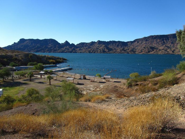 Tucked away in the mountainous landscapes of Parker and Lake Havasu City are several state parks that border the Colorado River. Each has a small beach area for swimmers to dive and boats to launch from but Cattail Cove is one with a particularly pretty beach scene.