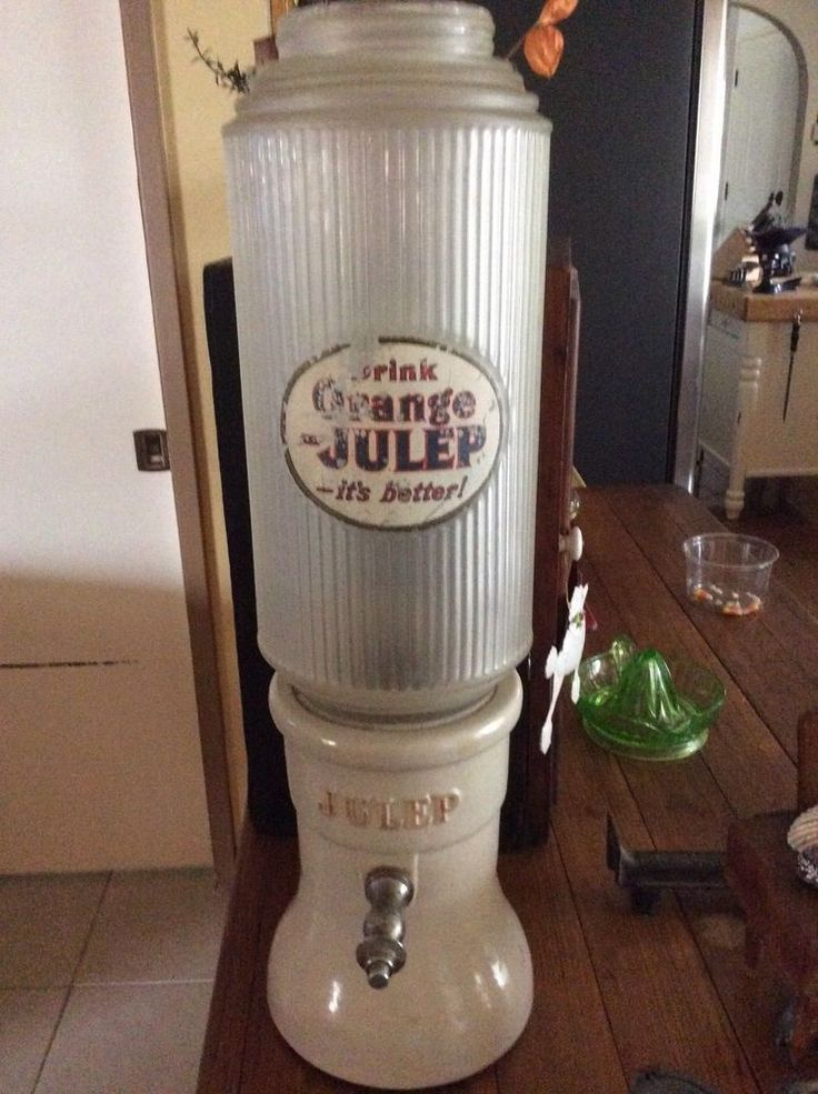 """Very Nice Early Orange Julep Soa Fountain Dispenser. Crock Base and Shaded Glass Top. Advertising consists of """"Julep"""" in relief on both sides of Crock and what appears to be painted On the Glass Top. 