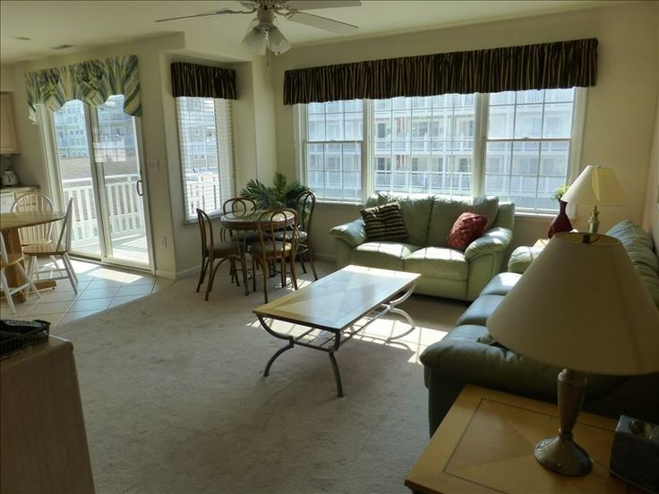 Beautiful and efficient upgraded windows, and sliding glass door accesses to the balcony.