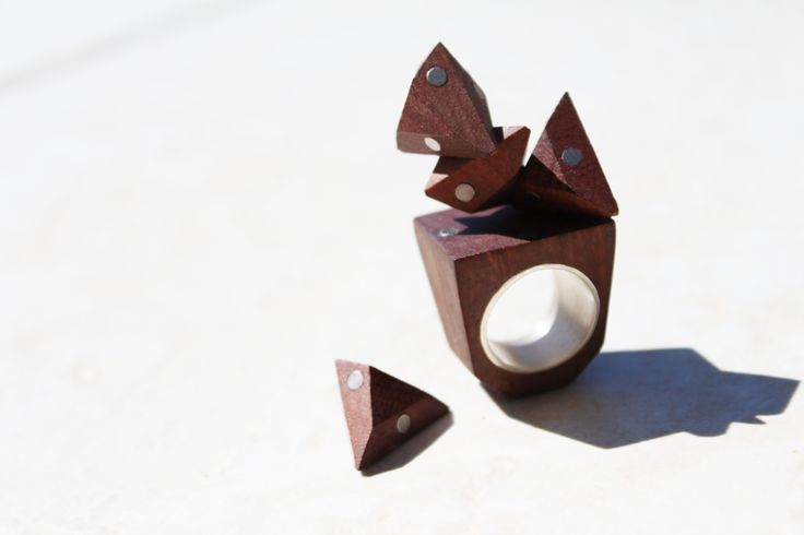 """Interchangeable magnetic polyhedron ring"" (2012)  (jarrah, rare earth magnets, sterling silver)"