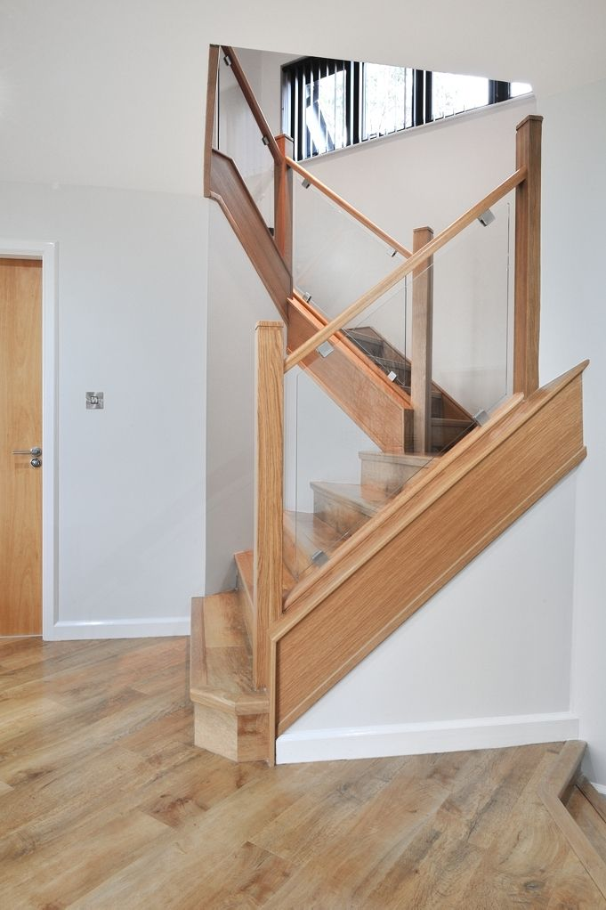 Beautiful classic glass staircase taking advantage of the natural light coming in from the massive expanse of windows and bi-fold doors at the back of their house
