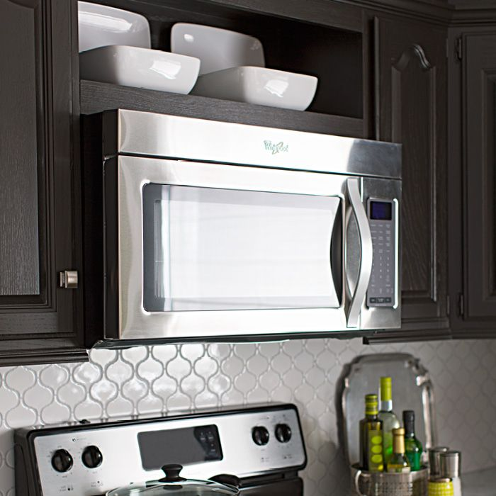 Create new space in your kitchen. Free up counter space by swapping your countertop microwave for an over-the-range model. Then turn a slice of cabinet space above the microwave into an attractive display shelf.
