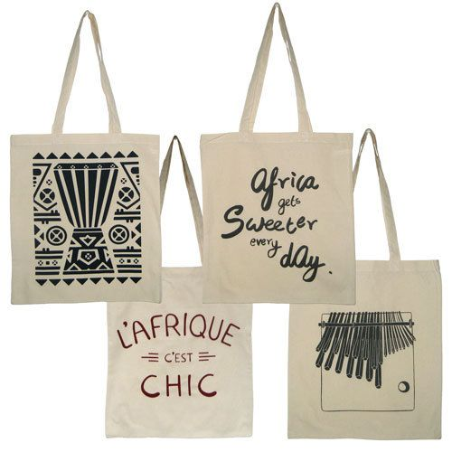 CAN Creativity and Noise  AfriCAN Tote Bag in Natural.  £5.00 each  AfriCAN Tote Bag in Natural. A simple classic, tote bag for the everyday. Select your desired print front from L'Afrique C'Est Chic in Maroon, Africa Gets Sweeter Every Day in Pearl Black, Mbira in Slate or Beat It in Denim.