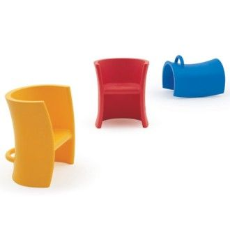 Trioli children's chair. A rocker, a low seat chair, and a higher seat chair all in one. Design: Eero Aarnio 2005 for Magis.