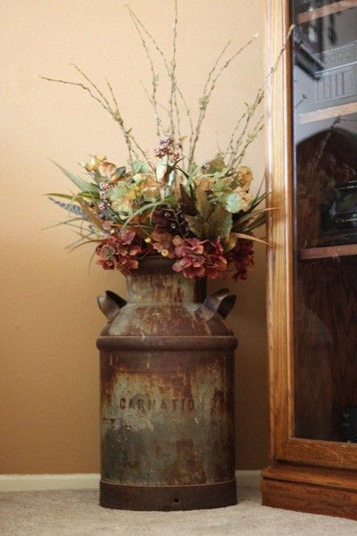 Milk can fresh greenery and flowers.  Hmmm.....I have my grandmas old milk can!