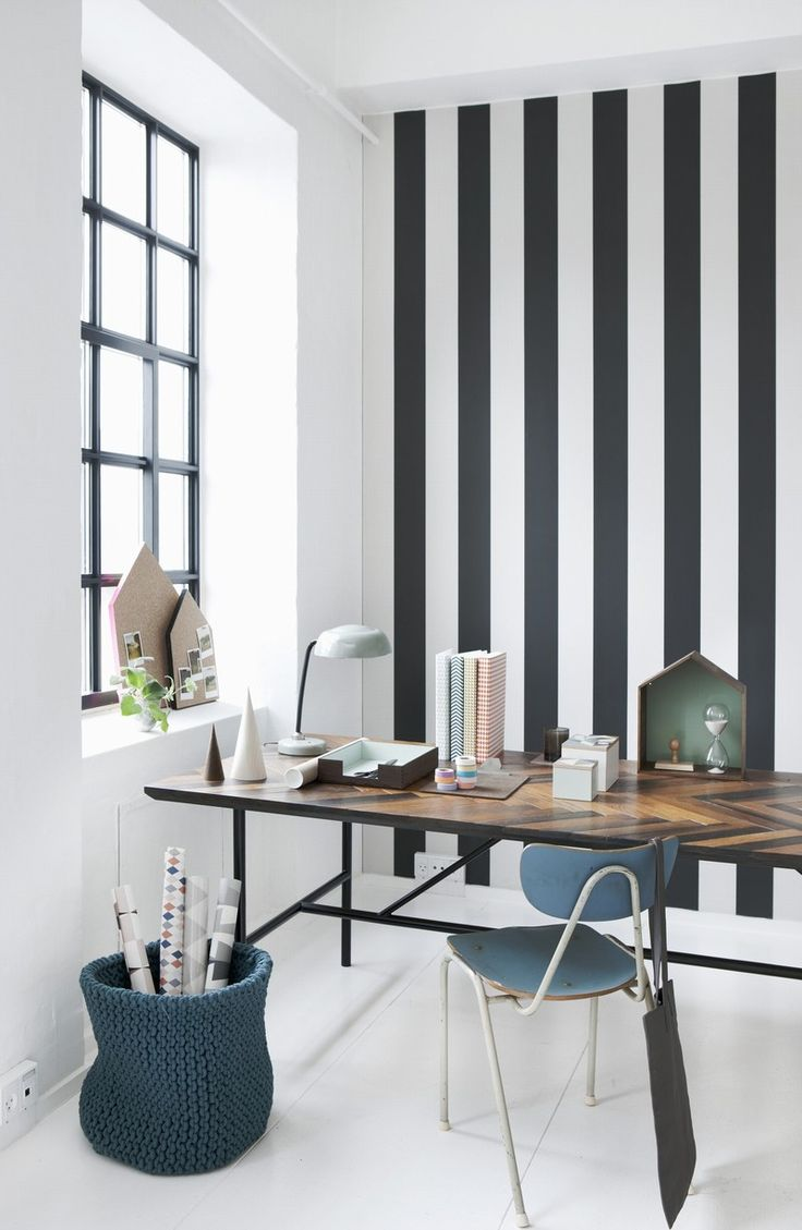 So many things to love in this office-knitted waste basket, striped wall, chevron desk top, or the window...?