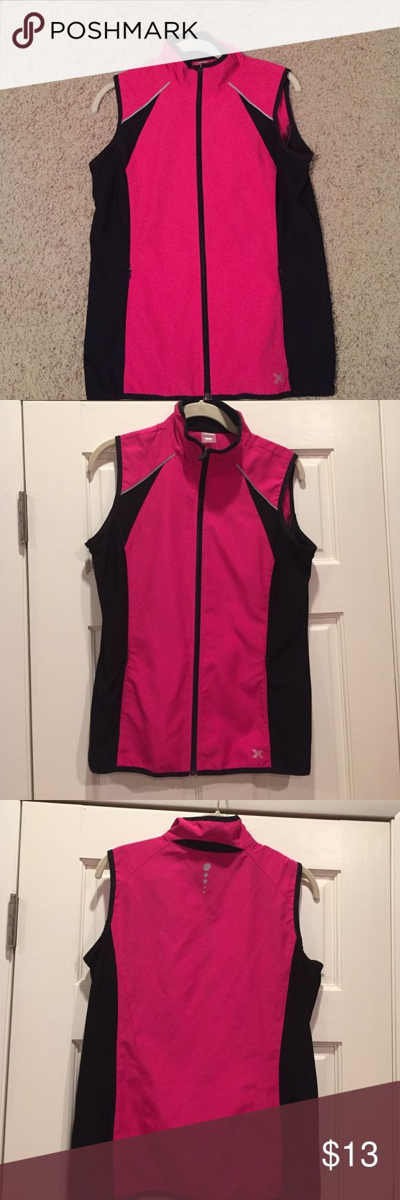 Athletic vest Athletic Vest, size M, brand Xersion. Gently worn, Black, Fushia Pink. Has black stretch side panels. Great add on layer to create a cute athletic look or to throw on over your sports bra or tank top after working out. xersion Jackets & Coats Vests