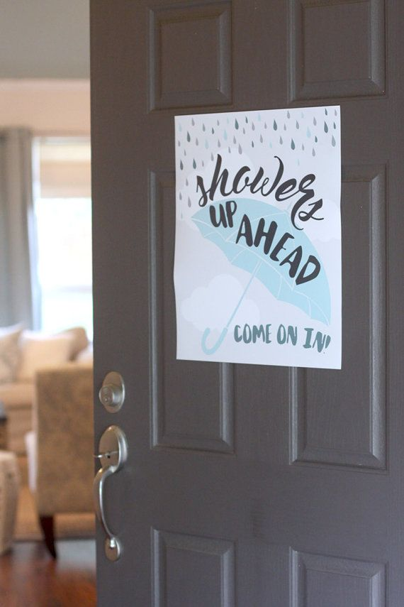 "Welcome your baby shower guests with a ""rainy"" poster."