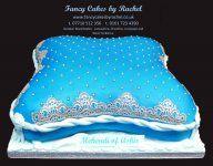 blue mehndi pillow cake