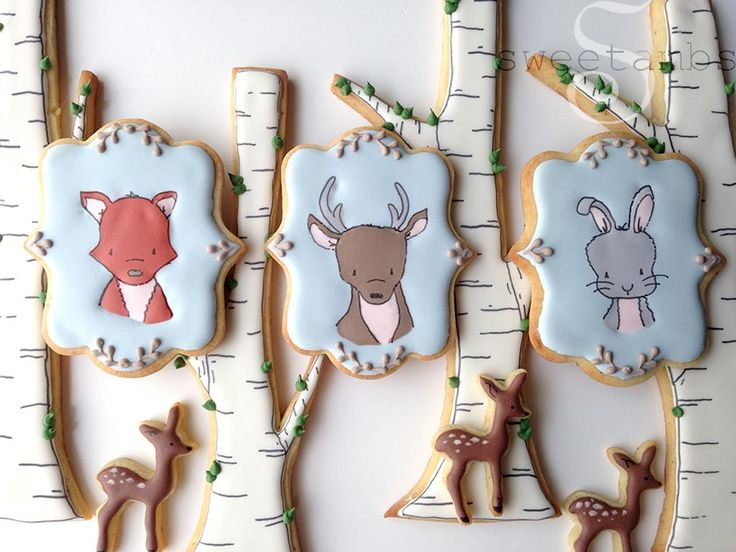 These woodland cookiesarebased on some of my favorite illustrations by Carrie ofSweet Melody Designs. Visit her website to see more of her adorable nursery art and browse through her online shop for prints, pillows, and nursery bedding. -- He