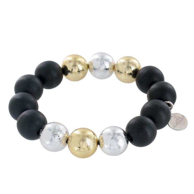Aarikka - Bracelets : Revontuli bracelet. Flaming magic of the Northern skies. The Revontuli (Aurora Borealis) piece's gold and silver shine enhances the deep colours. Designer: Pauliina Aarikka.