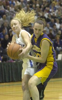 Hoosic Valley's Rachel Moore battles with Voorheesville's Jennifer Cillis for the ball during first quarter of Class 'C' high school girls final basketball action Friday, March 2, 2012 in Edward F. McDonough Athletic Complex at HVCC. (J.S. Carras / The Record)