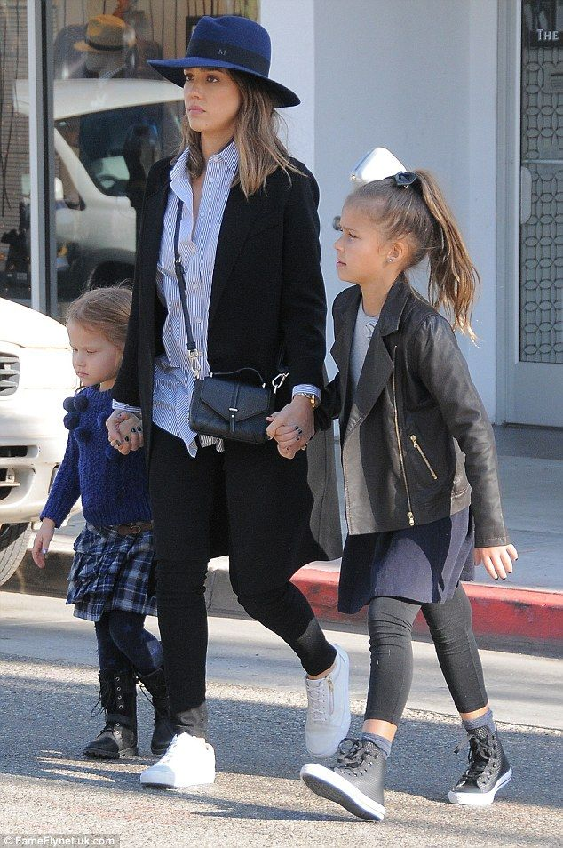 Stylish simplicity: Jessica opted for some black leggings, white sneakers and a blue and w...