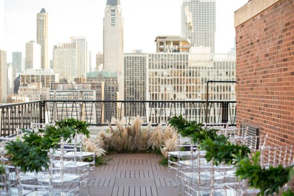 Rooftop Wedding Ceremony | photography by Julia Franzosa http://juliafranzosaphotography.com Floral Design: Vale of Enna Chicago