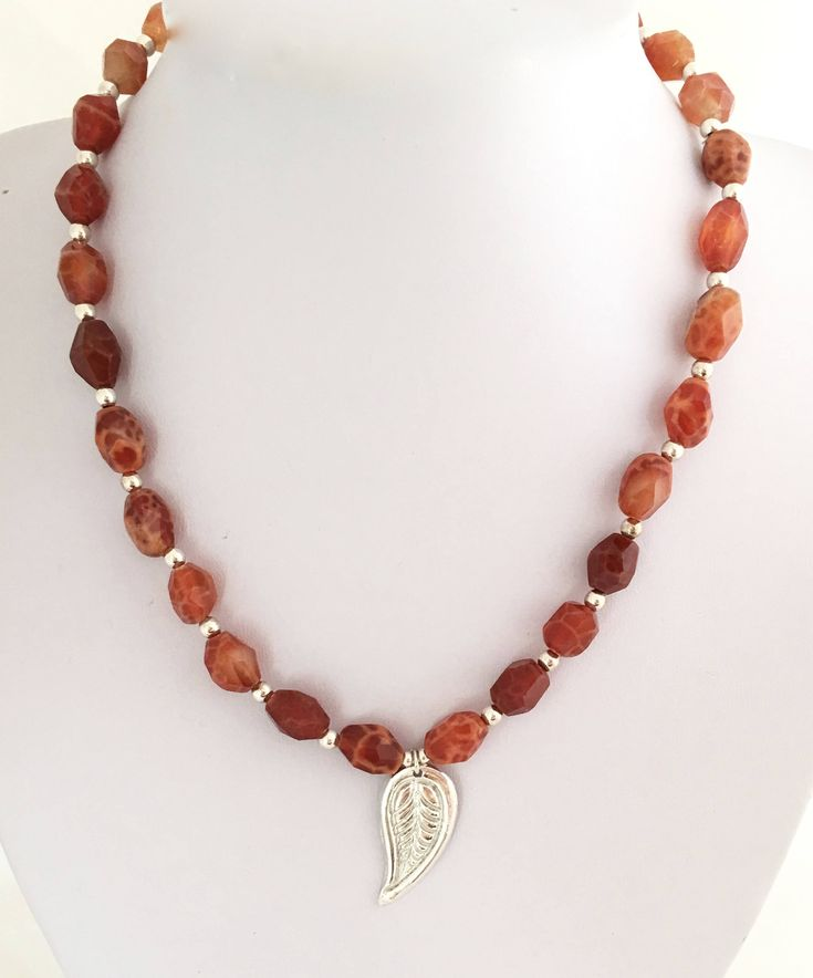 Fire Agate beads with a Pure Silver (.999) leaf motif pendant necklace by NuitNuitDesigns on Etsy https://www.etsy.com/uk/listing/528112034/fire-agate-beads-with-a-pure-silver-999