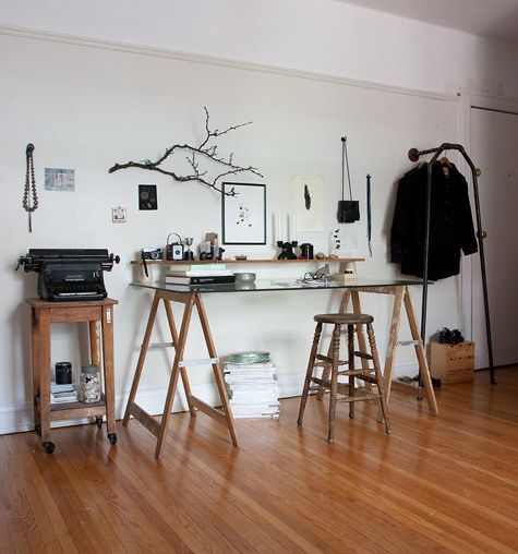 """nikole of herriott grace / assembled desk / DIY coat rack """"desk is made from old sawhorses I """"borrowed"""" from my father's shop... The small jars that hold up the cedar shelf are yogurt pots from a trip to China."""" Coat rack is made from piping."""