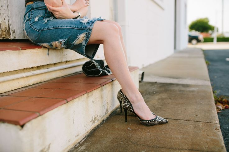 Distressed jean skirt style with studded heels by Jimmy Choo