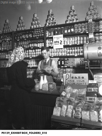 """Zwerner Grocery Store During WWII, Terre Haute, Indiana, 1945 """"Please have your ration points"""" on sign."""