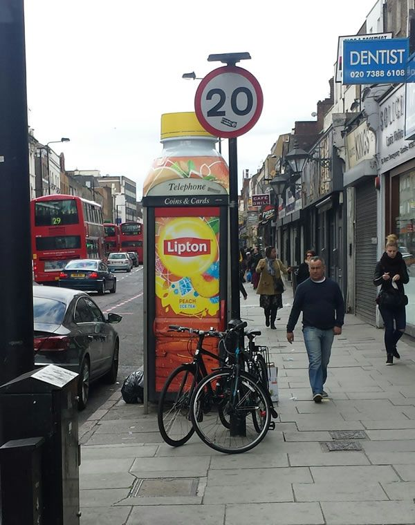 BT's latest telephone box advertising - a telephone box made to look like a bottle of Lipton Peach Ice Tea.