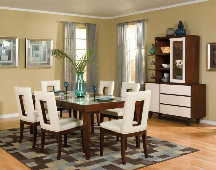 add a contemporary flare to your dining room with this sleek dining set