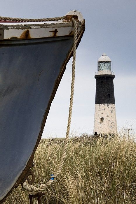 orchidaorchid:  Abandoned Boat And Lighthouse.  By John Short